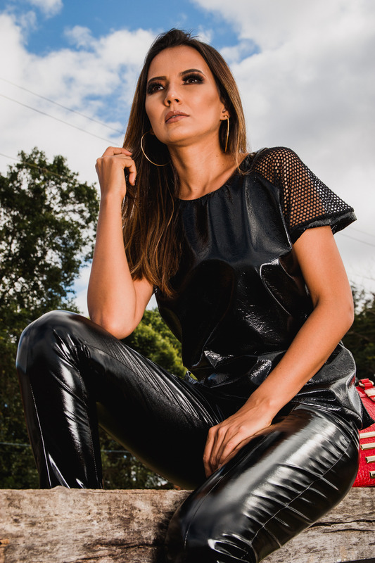 canva-woman-in-black-leather-pants-sitting-on-log-MADGvvq-qy8